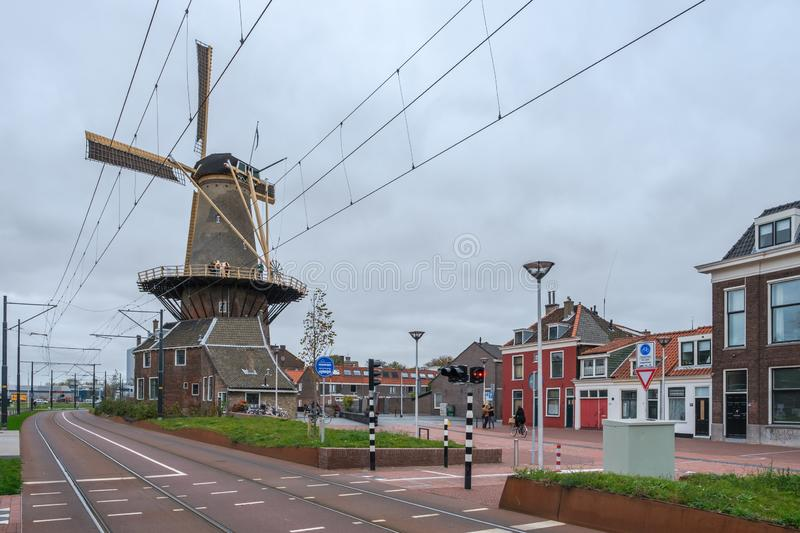 A new road and a tramway along the old city windmill de Roos in Delft, the Netherlands stock images