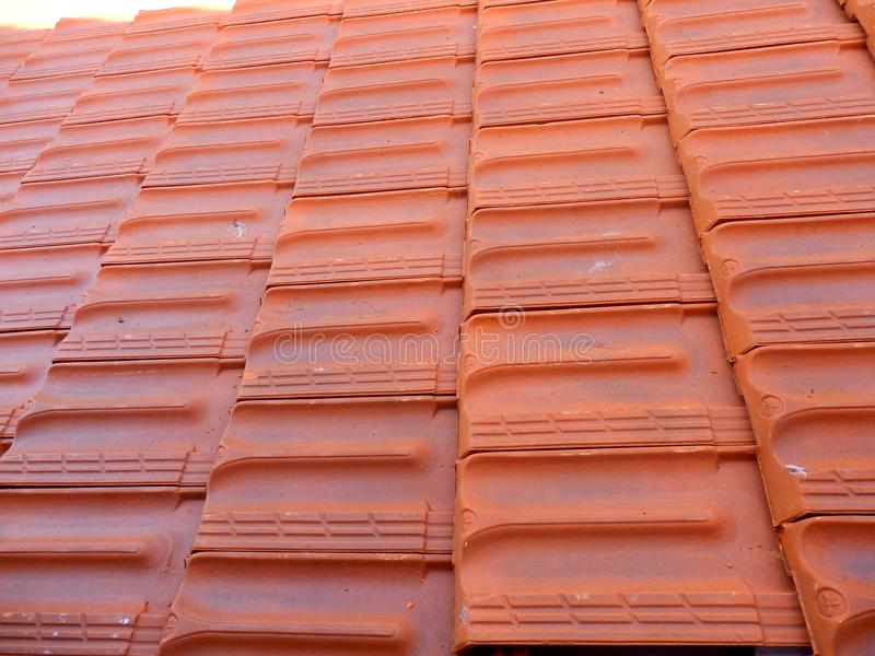 New Roof Tiles. Installed following replacement of old terracotta roof tiles stock photos