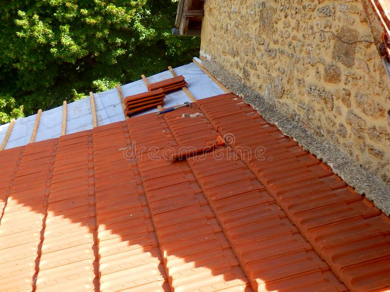 New Roof Tiles. Installed following replacement of old terracotta roof tiles royalty free stock photography