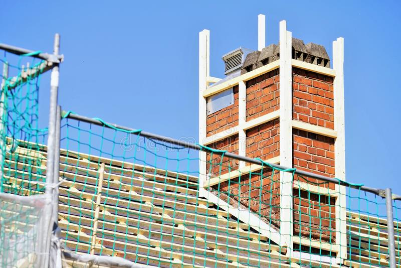 New roofing with chimney royalty free stock photography