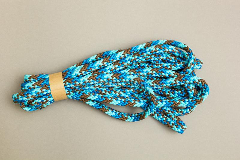 A new rope on a gray background stock image