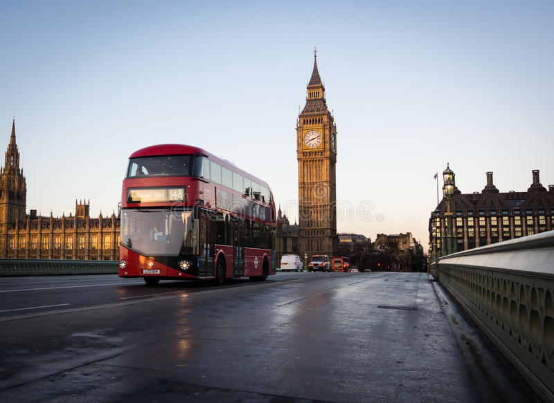 New Routemaster bus. On Westminster Bridge with United Kingdom Parliament in the background stock image