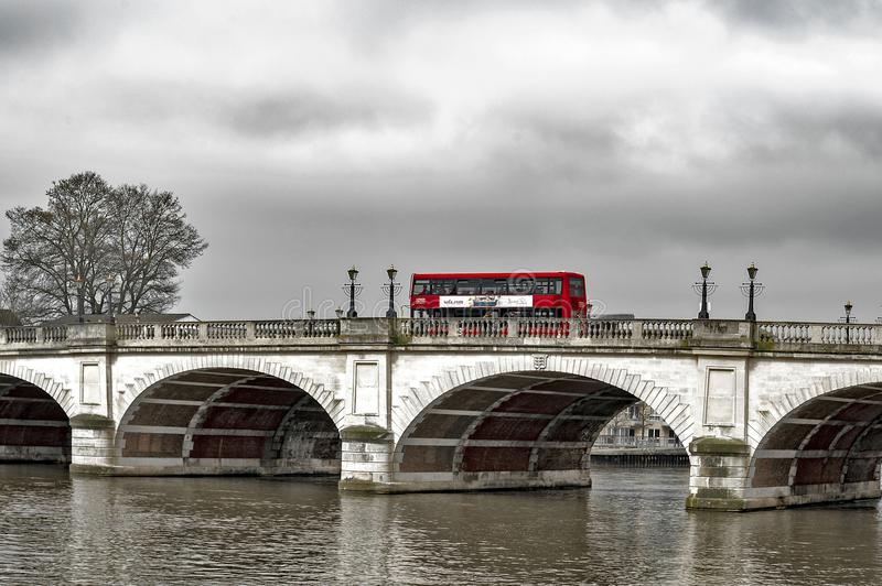 New Routemaster Double-decker bus crossing Kingston Bridge over the River Thames in Kingston, England. Kingston upon Thames, United Kingdom - April 2018: New royalty free stock photo