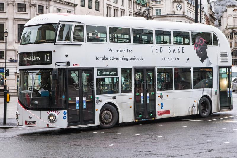 New Routemaster in White Livery at Trafalgar Square. London, United Kingdom - December 23, 2019: Wrightbus New Routemaster in white livery travelling around royalty free stock photography