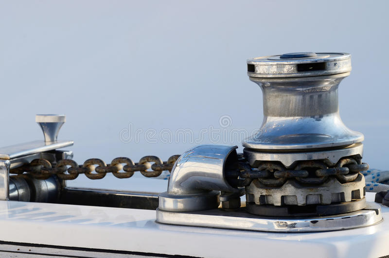 New sailboat anchor winch with chain, equipment for yacht control royalty free stock photography