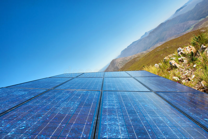 Download 'New Sky' - Blue Solar Cells And Awesome Mountain Stock Image - Image: 6694819