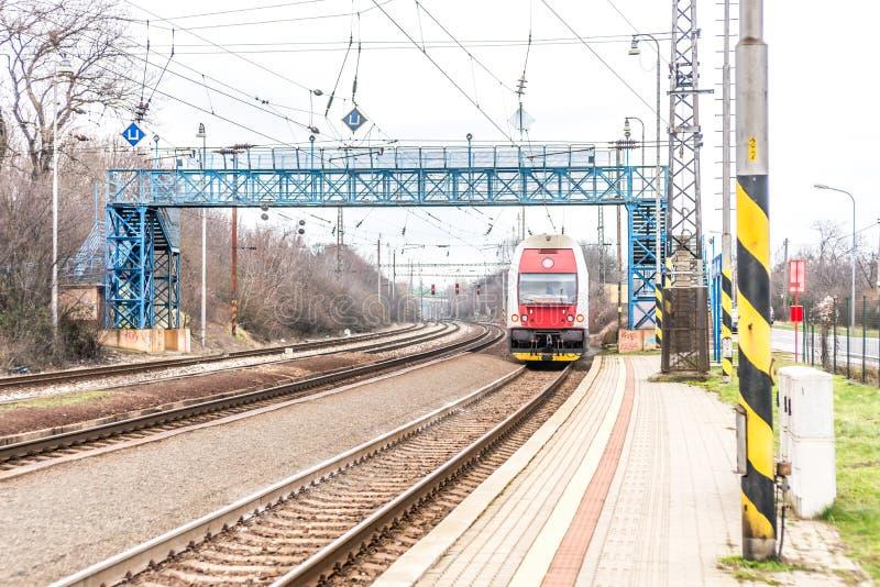 New Slovak red train under blue bridge royalty free stock images