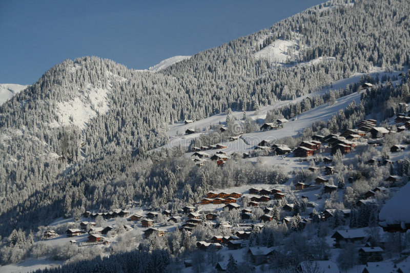 New snow on chalets in village,. Alpine valley with new snow and chalets, Chatel,French Alps,France royalty free stock photos