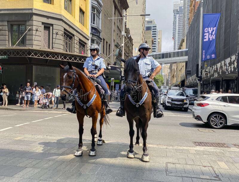 New South wales police riding on their horses at Sydney Downtown. royalty free stock photography