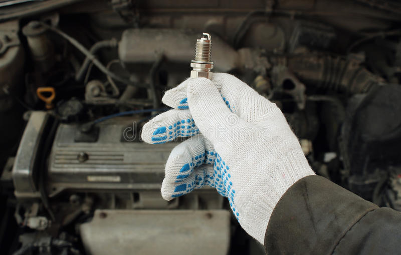 A new spark plug. In hand stock photo