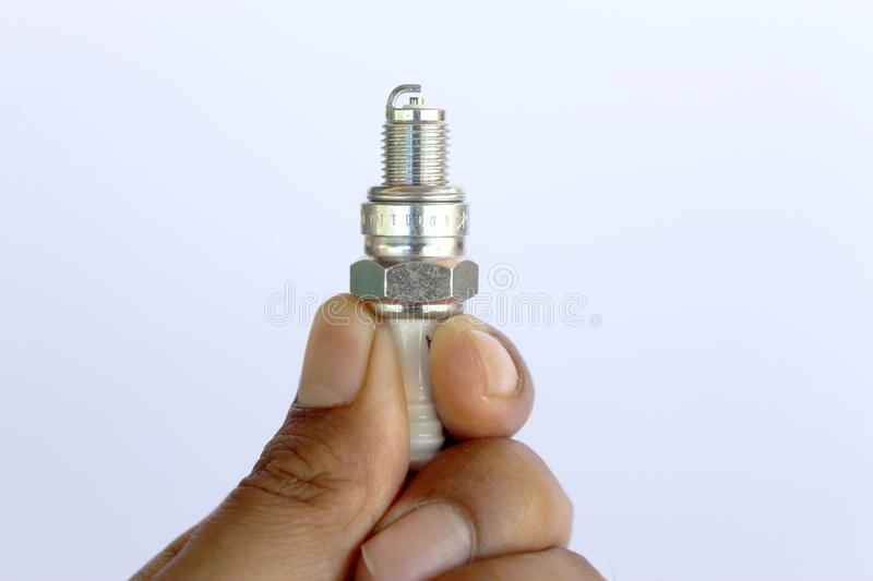 New spark plug in hand before use royalty free stock images