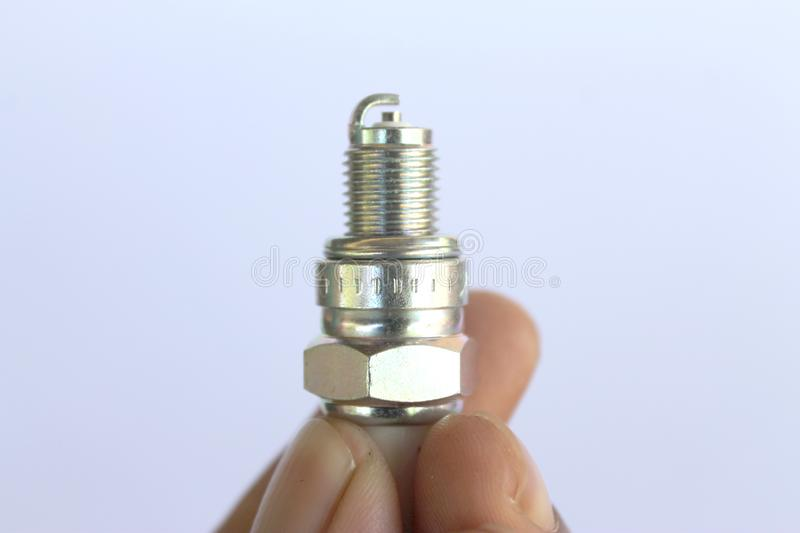 New spark plug in hand before use royalty free stock image