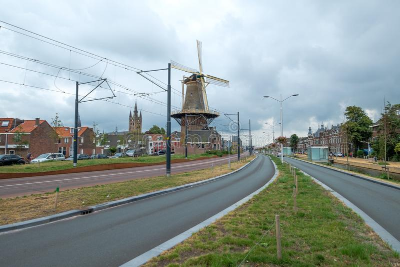 The new Spoorsingel with the mill and leaning tower in Delft, Netherlands royalty free stock image