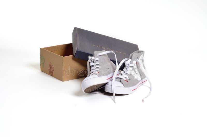 New sportsmanlike shoe with shoebox stock photo