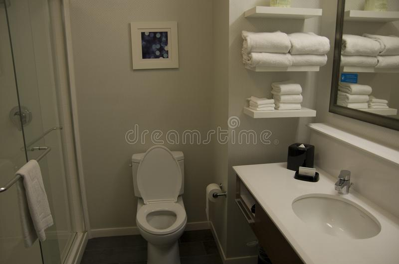 Small neat hotel bathroom design. A new 3 star hotel bathroom with practical design. It is neat and modern stock images