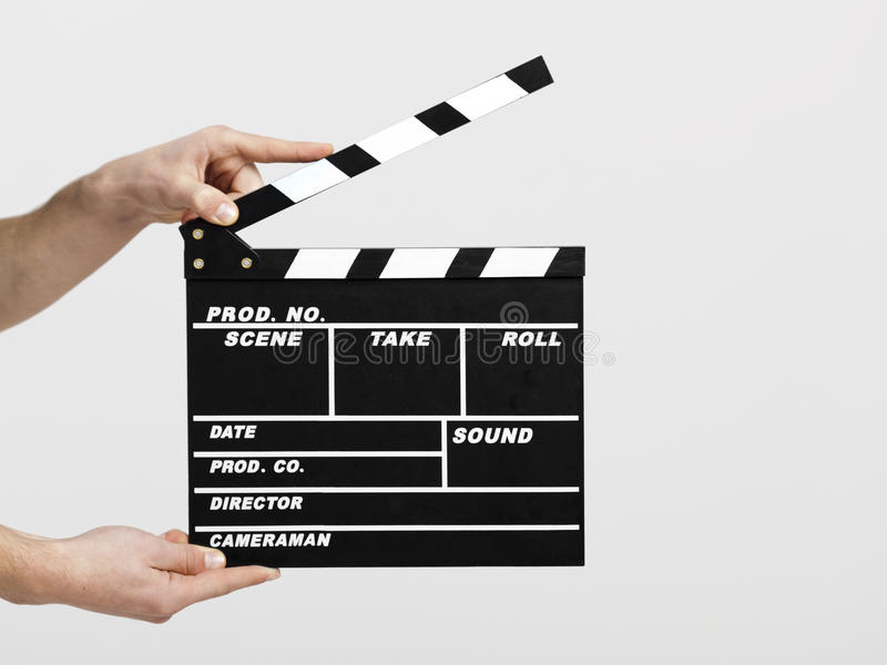 New start. Male hands holding a clapboard, great conceptual image for ex, a new start your business royalty free stock photos