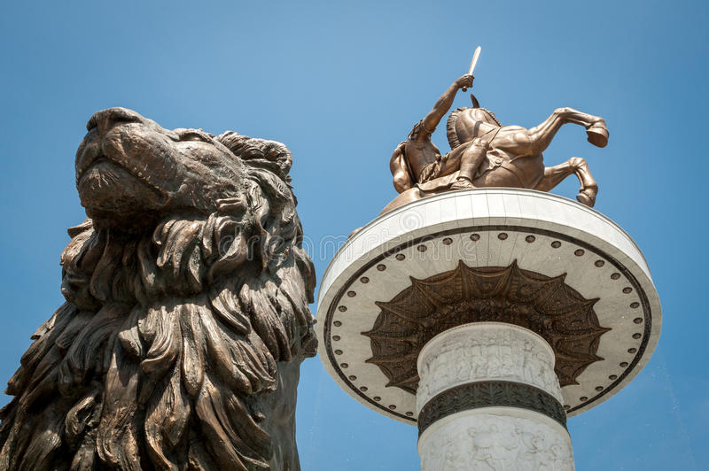New statue of Alexander the Great with statue of lion in front o royalty free stock image