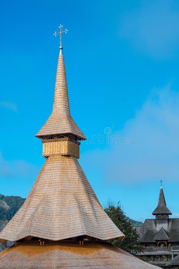 New, steep, dovetail shingle roof at Barsana Monastery, Romania. Recent roof made with dove-tailed wooden shingles, displays the typical, tall form of religious royalty free stock image