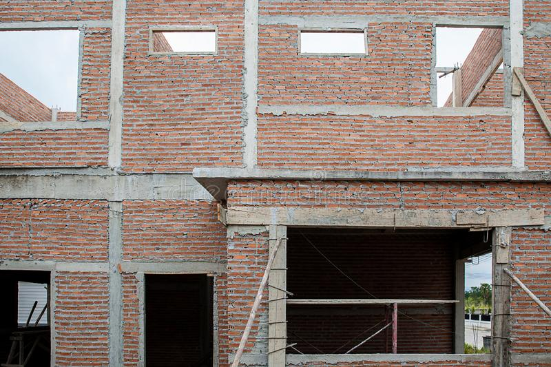 A new stick built home under construction. construction residential new house in progress at building site. The building structure are made from prefabrication royalty free stock photo