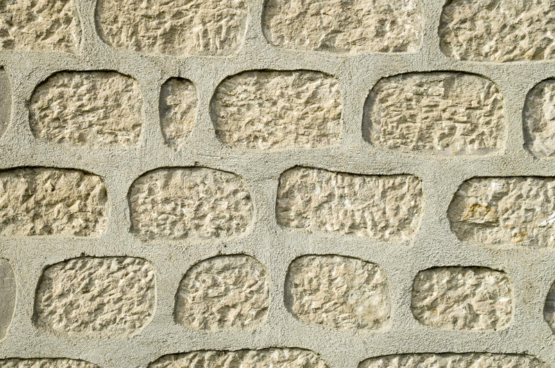 New stone wall closeup. In sunny day royalty free stock images