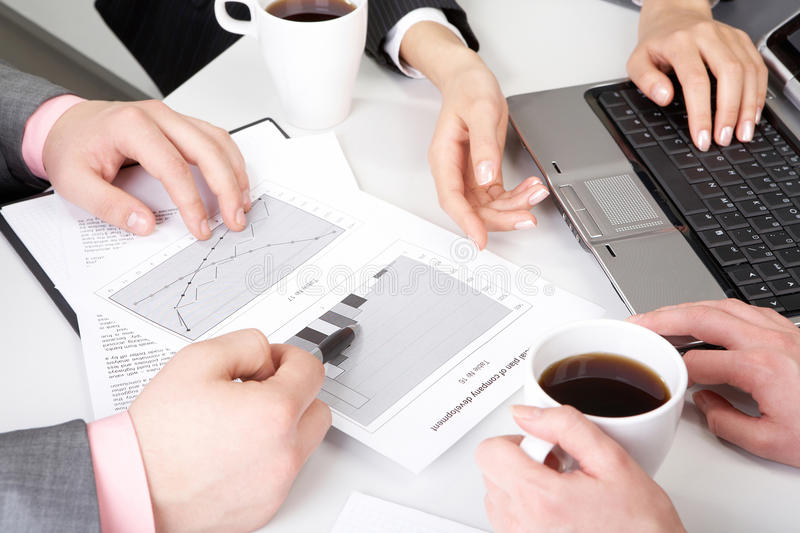 New strategy. Image of workteam working with documents at business meeting royalty free stock photography