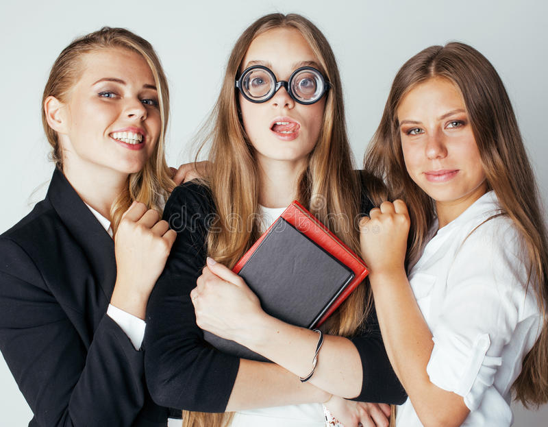 New student bookwarm in glasses against casual group on white, teen drama, lifestyle people concept. Close up royalty free stock photos