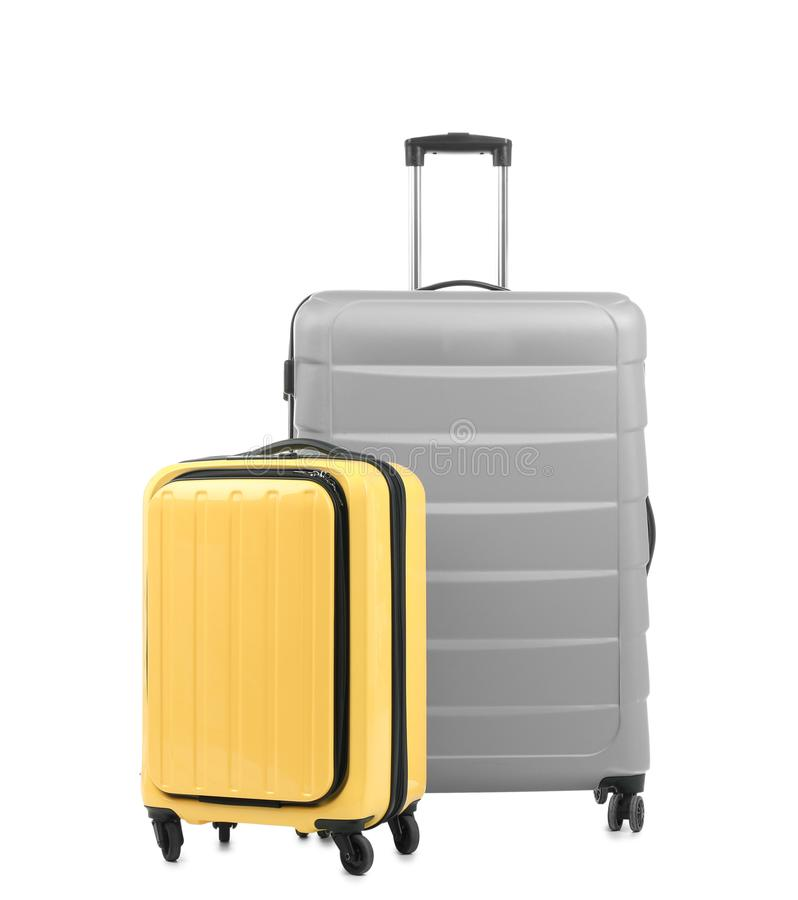 New suitcases on white background. New suitcases packed for journey on white background royalty free stock photo