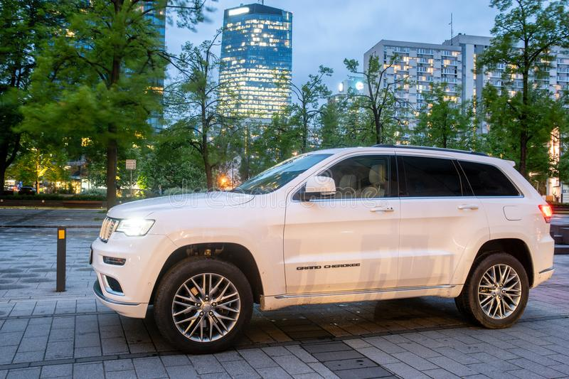 New SUV Jeep Grand Cherokee model against the background of modern buildings in Warsaw. Warsaw, Poland-April 2018: New SUV Jeep Grand Cherokee model against the stock image