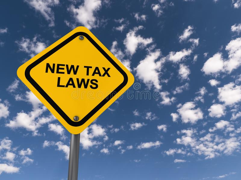 New tax law traffic sign. On blue sky stock photos