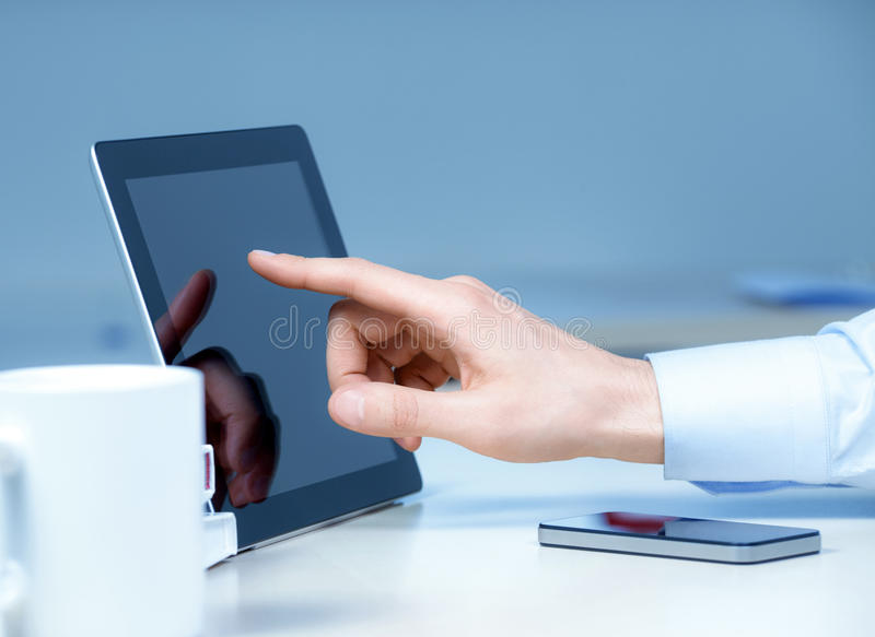 New Technologies At The Workplace. Hand pointing on modern digital tablet pc at the workplace