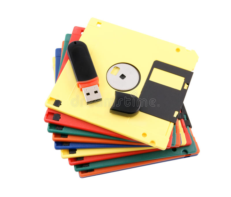 New technology concept. Flash drive over old diskette stack royalty free stock photo