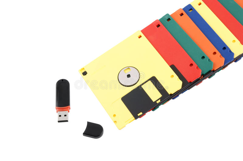 New technology concept. Flash drive over old diskette stack royalty free stock photography