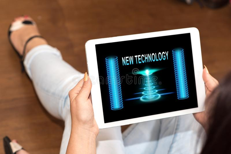 New technology concept on a tablet. Tablet screen displaying a new technology concept stock photos