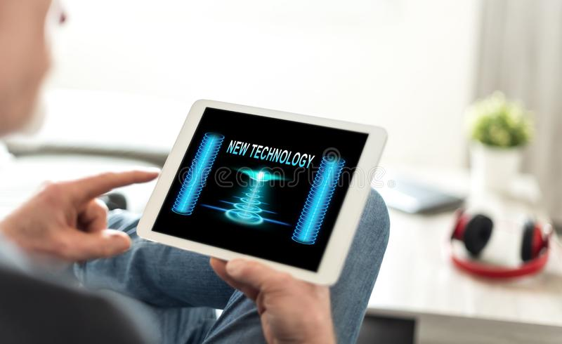 New technology concept on a tablet. Tablet screen displaying a new technology concept royalty free stock photo