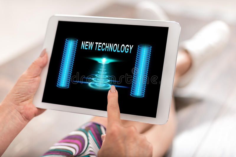 New technology concept on a tablet. Woman using a tablet with new technology concept royalty free stock photos