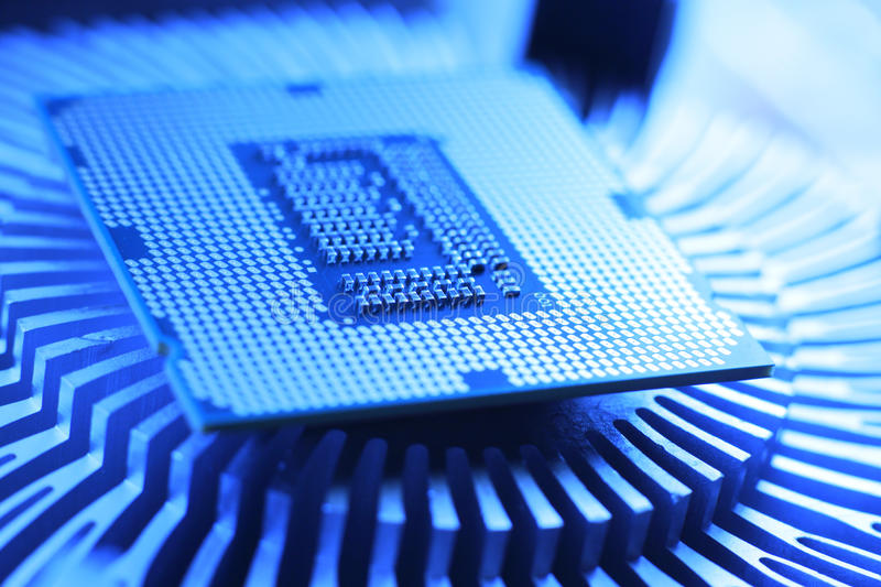 New Technology Processor. Closeup of a processor and aluminium radiator stock images
