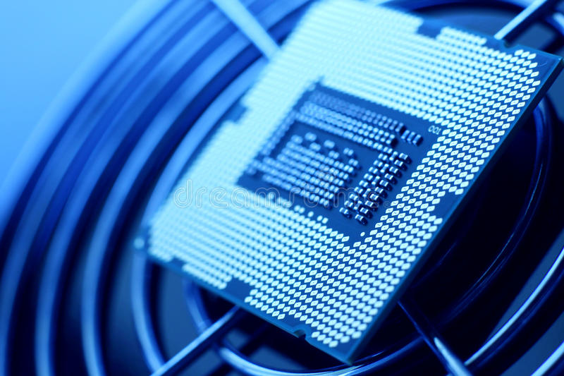 New Technology Processor. Closeup of a processor and steel grid royalty free stock photos
