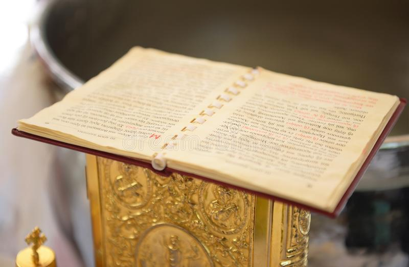 The New Testament at a greek Orthodox christening stock image