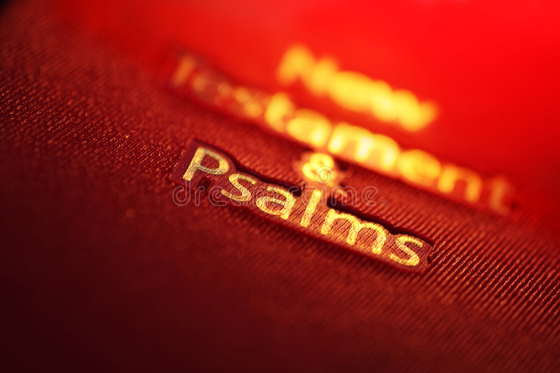 New Testament and Psalms book. With red and gold text stock images