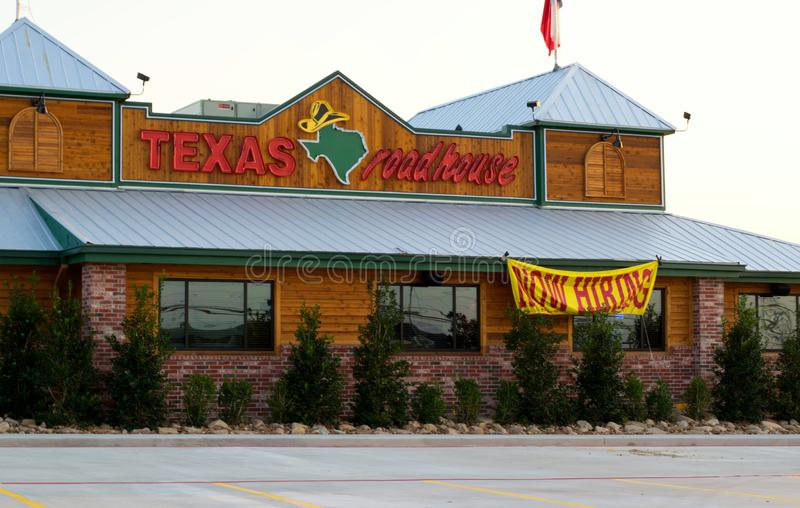 New Texas Roadhouse restaurant in Humble, Texas. Houston, Texas/USA 09/06/2019: Texas Roadhouse restaurant being prepped for opening in Humble, TX with a hiring royalty free stock images