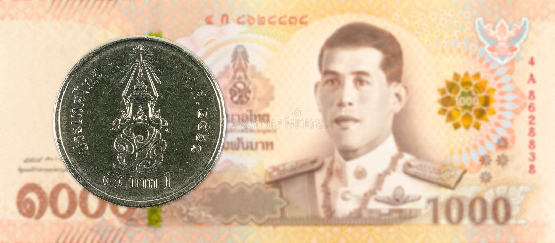 1 new thai baht coin against 1000 new thai baht banknote stock photos
