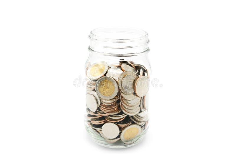 New Thai Baht coins in a glass jar. stock photos