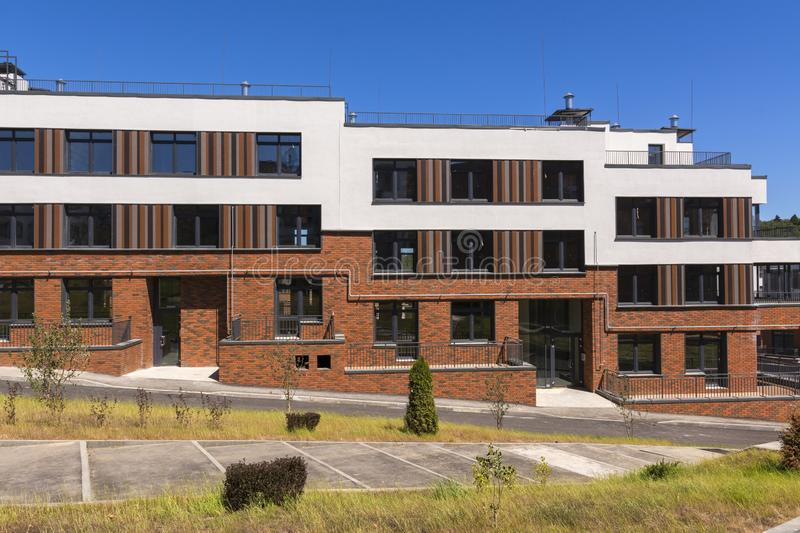 New three-storey residential building with large Windows.  stock photography