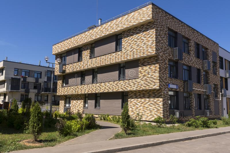 New three-storey residential building. New residential area.  stock photos