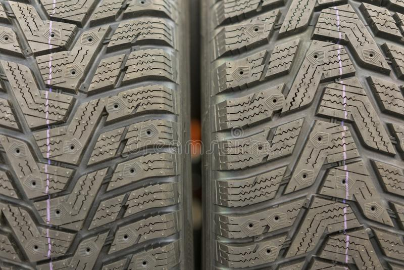 new tires for sale at booth in store. Winter Season Tire Tread. Brand New Car Tires on the Shelf stock image