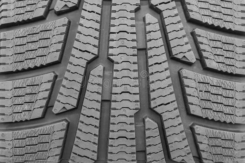 New tires for sale at booth in store. Winter Season Tire Tread. Brand New Car Tires on the Shelf. background.  royalty free stock images