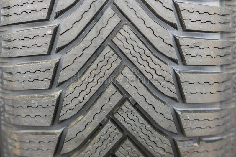New tires for sale at booth in store. Winter Season Tire Tread. Brand New Car Tires on the Shelf. background.  royalty free stock photo