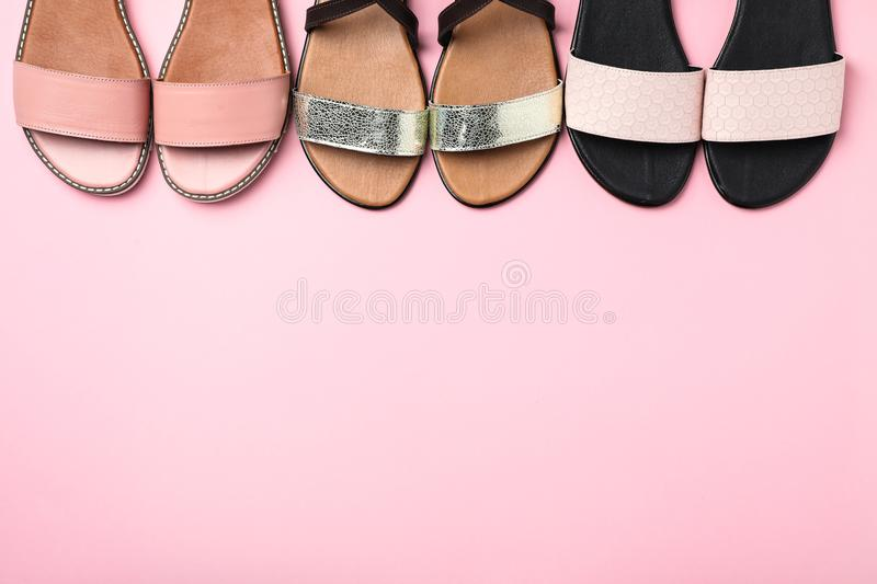 New trendy women`s shoes on color background. Top view stock image