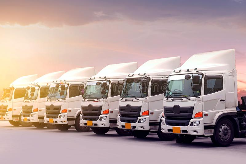New truck fleet is parking at yard during sunset royalty free stock photography