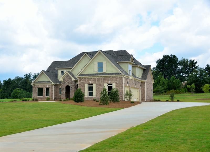 New two story brick home in Georgia, USA. Two-story brick house or home with hip syle roof in new development in Bogart, Georgia, USA royalty free stock images